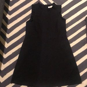 Black loft dress with ruffle detail on arms. 14